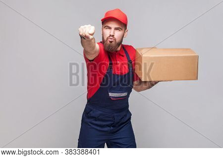 Superman! Young In A Hurry Logistic Delivery Man With Beard In Blue Uniform And Red T-shirt Standing