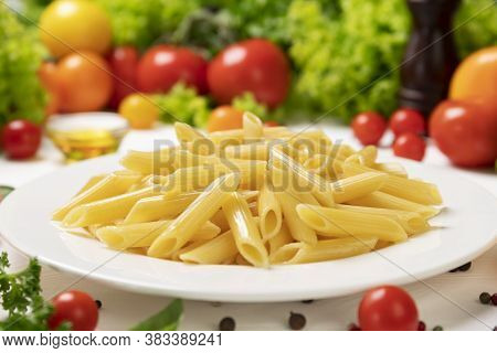 Plate Of Cooked Italian Pasta On White Table