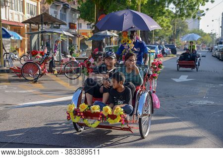 George Town, Penang/malaysia - Apr 30 2017: A Family Visit Georgetown By Rickshaw.