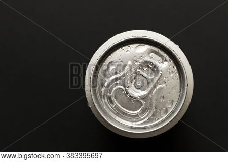 A Chilled Can Of Beer On A Dark Background. The View From The Top. Close Up