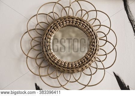 Vintage Rattan Mirrors On White Textured Wall. Round Mirror With Frame Of Eco Straws