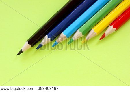 Colored Pencils On A Green Background. Lots Of Different Colored Pencils. Colorful Pencil. Close. Pe