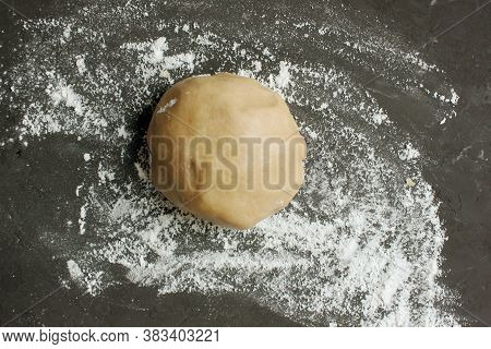 Ginger Cookie Dough On Floured Black Surface. View From Above. The Dough Has A Brown Tint. Cooking G