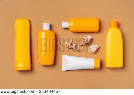Assortment Of Sunblock Creams On Beige Background