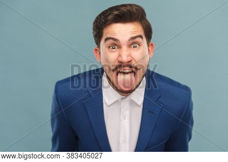 Portrait Of Man With Big Eyes, Tongue Out And Shout