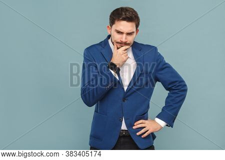 Let's Me Think. Pondering Young Adult Man Touching Chin