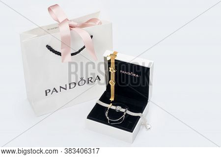 Kyiv, Ukraine - May 21, 2020: Pandora Paper Bag With Gift Box On White Table. Bracelets With Golden