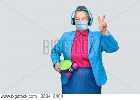 Trendy Funny Grandmother With Headphones And Skateboard And Surgical Medical Mask Showing Peace Sign