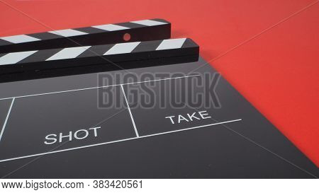 Black Clapperboard Or Movie Slate. It Use In Video Production Or Film And Cinema Industry On Red Bac