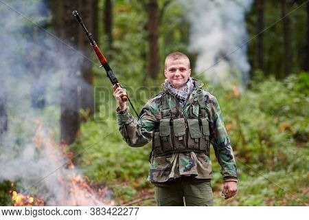 angry terrorist militant guerrilla soldier warrior in forest