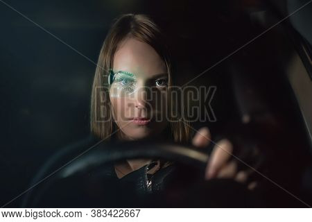 Woman In The Sci Fi Futuristic Eyeglasses Sits By The Car Steering Wheel.