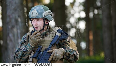 Modern Warfare Soldier Commander  Officer Talking Portable Radio Station and Give Orders Subdivision Squad
