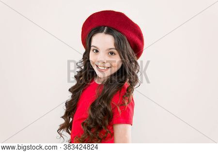 Smiling Child. Kid Girl Long Healthy Shiny Hair Wear Red Hat. Little Girl With Long Hair. Kid Happy