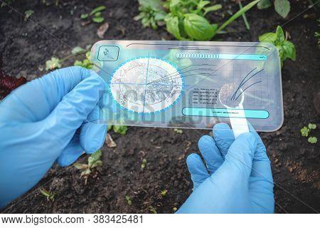 A Scientist Analysing Soil Dirt By Digital Sci Fi Digital Scanner.