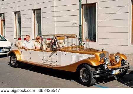 Prague, Czech Republic - June 03, 2017: Travelers Sit In Old Car. Vintage Vehicle Parked At Street.