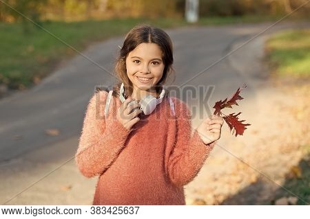 Kid Girl Relaxing Autumn Leaf With Modern Wireless Headphones. Listening Songs. Melody For Good Mood