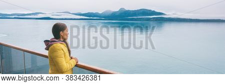 Alaska Glacier bay cruise ship travel tourist looking at icebergs inside passage from balcony deck view Scenic cruising vacation destination panoramic banner.