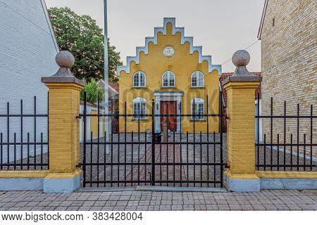 Yellow Mansonic Lodge With Symbols Behind An Iron Gate, Faaborg, Denmark, August 16, 2020