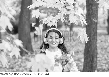 Crispy Autumn Air. Happy Small Child Smile Listening To Music On Autumn Day. Little Girl Play On Fre