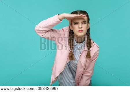 Looking Too Far. Portrait Of Beautiful Cute Girl Standing With Makeup And Brown Pigtail Hairstyle In
