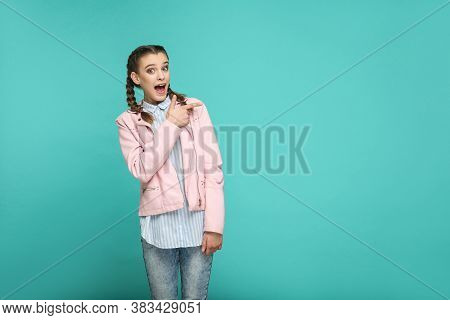 Surprised Face Pointing Copyspace Portrait Of Beautiful Cute Girl Standing With Makeup And Pigtail H