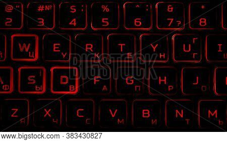 Black Computer Keyboard With Red Backlight In The Dark.
