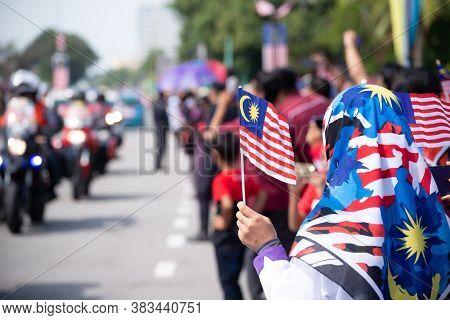 Butterworth, Kuala Lumpur/malaysia - Aug 31 2019: A Muslim Girl Hold Malaysian Tudung And Mask Wave