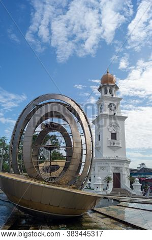 Georgetown, Penang/malaysia - Feb 14 2020: Georgetown Heritage Clock Tower With Fountain.