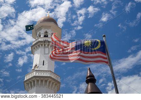 Georgetown, Penang/malaysia - Feb 14 2020: Malaysia Flag Wave At Kapitan Keling Mosque