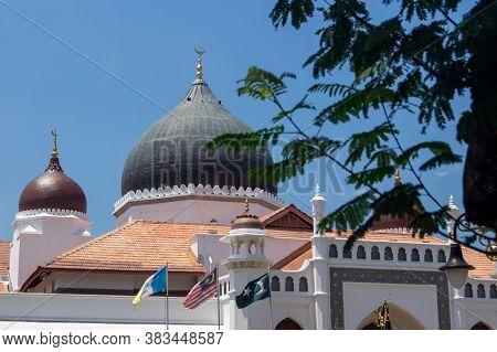 Georgetown, Penang/malaysia - Feb 28 2020: Masjid Kapitan Keling Mosque With Green Leaves.