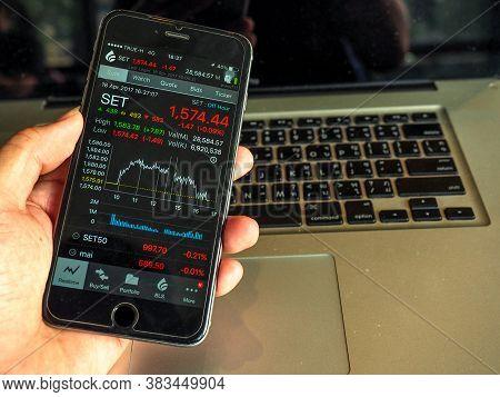 Bangkok, Thailand - April 18, 2017 : Businessman Buying Thai Stock Exchange Market  Forex Trade Inve