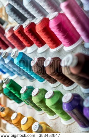 08.07.2018 -koblenz Germany - Closeup Of Colorful Spools Of Thread Yarn Sewing Equipment, Fabric And