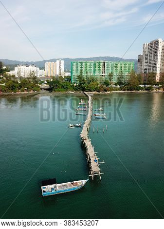 Georgetown, Penang/malaysia - Mar 17 2020: Aerial View Fishing Boat Park At Wooden Bridge.