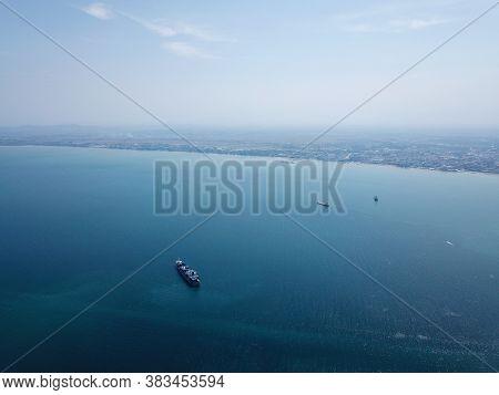 Georgetown, Penang/malaysia - Mar 17 2020: A Container Ship At Penang Sea. Back Is Peninsular Malays