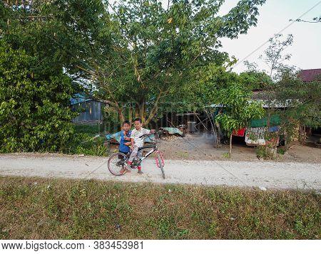 Seberang Perai, Penang/malaysia - Mar 20 2020: Malays Kid Cycle At Kampung.