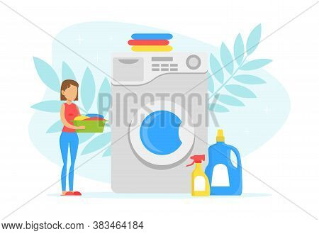 Tiny Young Woman Loading Big Washing Machine In Laundry Room, Laundry Process With Clean Clothes And