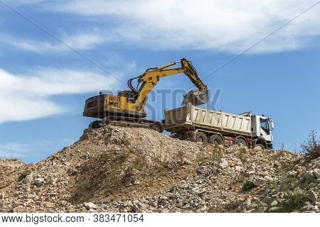 Loader And Truck Works On Construction Site