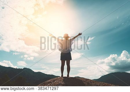 Copy Space Of Silhouette Woman Raise Hand Up On Top Of Mountain And Sunset Sky Cloud Abstract Backgr