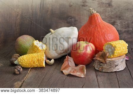 Various And Colorful Autumnal Vegetables And Fruits On Wooden Background