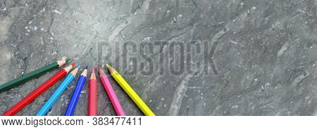 Colorful Wooden Pencils Arranged On A Grey  Marble Background In Panoramic View  And Copy Space At T
