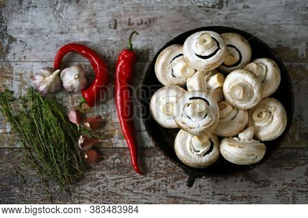 Raw Champignons In A Pan Before Baking With Seasonings. Cooking Champignons.