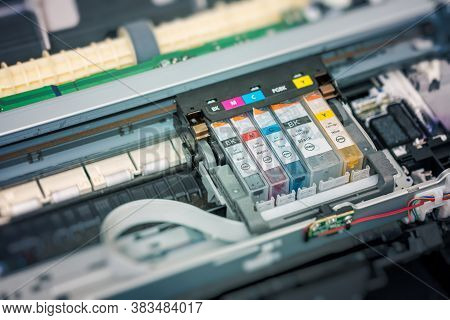 Replacement Of Cmyk Set Of Ink Cartridges In Printer.