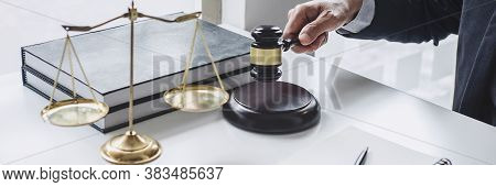Judge Gavel With Justice Lawyers, Counselor In Suit Or Lawyer Working  With Contract Papers On A Doc