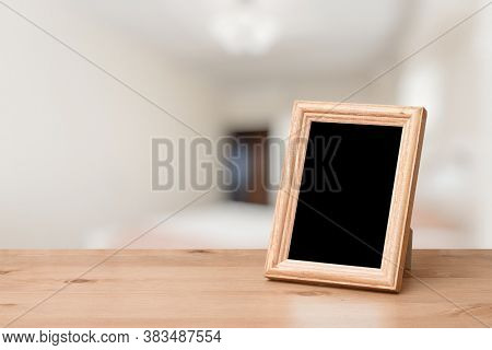 photo frame on the wooden table in the living room