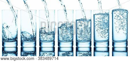 Pouring Water Into Glass Isolated On A White Background. Set Of Seven Filling Glasses.