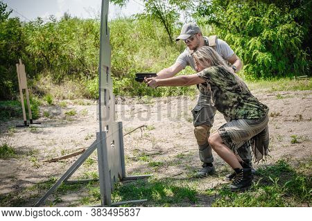 Instructor On Shooting Range Teaches His Female Student Tactical Gun Shooting Behind And Around Cove