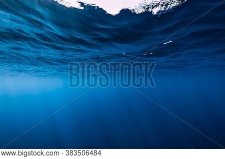 Underwater Background With Waves And Sun Rays. Transparent Underwater Ocean