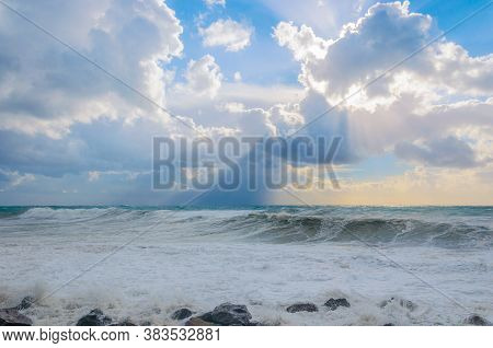 Storm On The Black Sea. Storm, Hurricane, Strong Wind. The Sun Shines Through The Clouds On The Swir