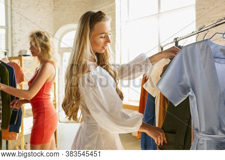 Wear, Clothing Shop During Sales, Summer Or Autumn Collection. Young Woman Trying Cloth, Looking For