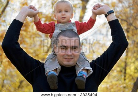 Father With Baby On Shoulders